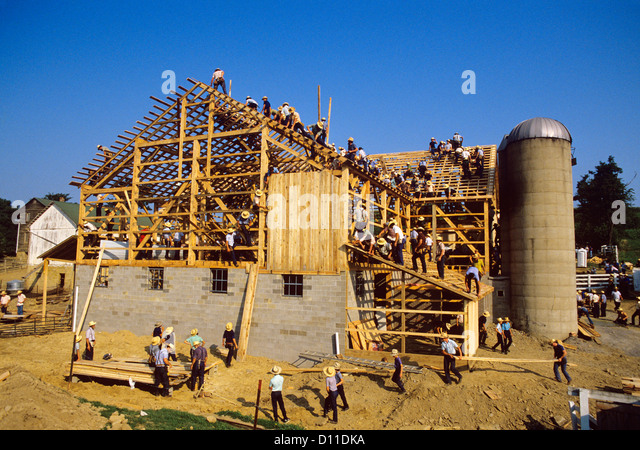 Old amish men stock photos old amish men stock images for Amish barn construction