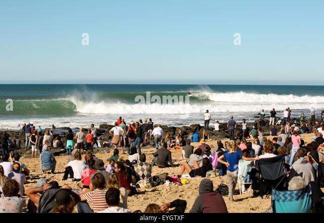 Large crowd on beach watching 2015 Jeffreys Bay World Surf League professional surfing event - Stock Image