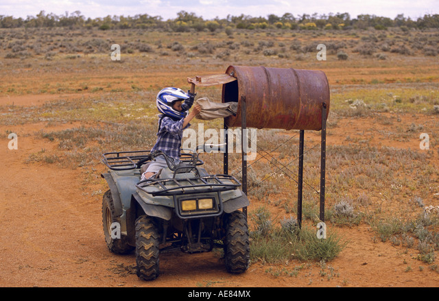 Leaving mail in airstrip letterbox outback Australia - Stock Image