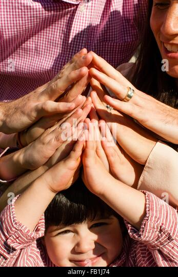Cropped view of family group holding hands together - Stock-Bilder