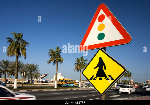 Qatar Doha arabian sign for crosswalk at the al corniche street in the background Museum of islamic art - Stock Image