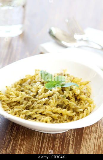Pasta with pesto sauce - Stock Image