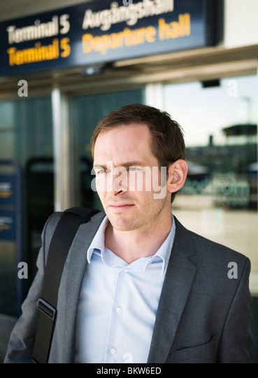 Man outside departure hall - Stock Image