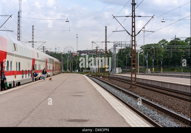Passengers getting off a Pendolino train at Helsinki railway station on a summer day. - Stock Image