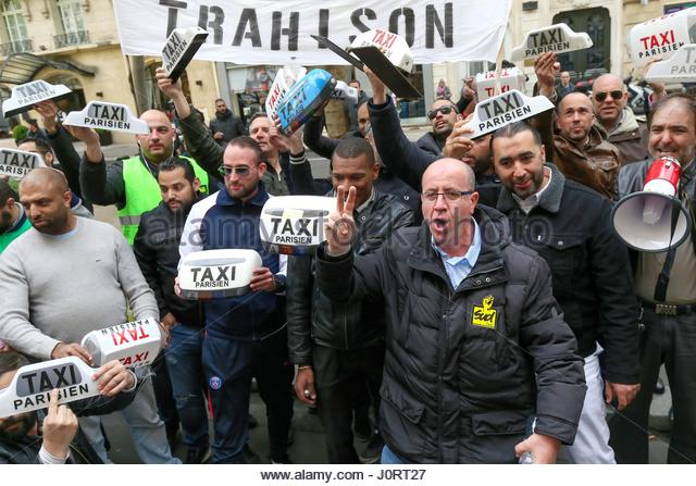 Paris, France. 14th Apr, 2017. Taxi drivers hold their taxi lights during a protest outside the office of Transportation - Stock Image