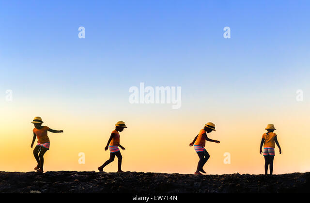 Multi exposure image of a girl moving around - Stock-Bilder