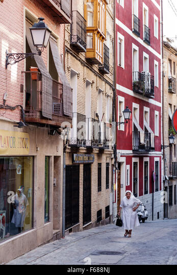 Spain Europe Spanish Toledo historic district buildings narrow street balconies nun nurse resident residences - Stock Image