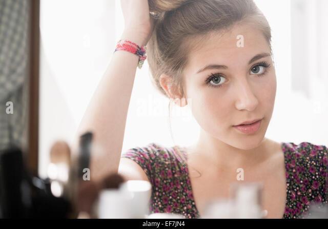 Teenage girl looking at mirror - Stock Image