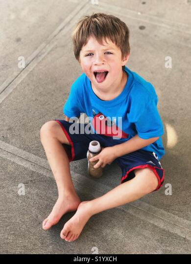 Little boy sticking tongue out - Stock Image