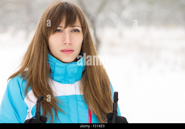 Young woman skiing at winter outdoor. Image with Copy space aside - Stock Image