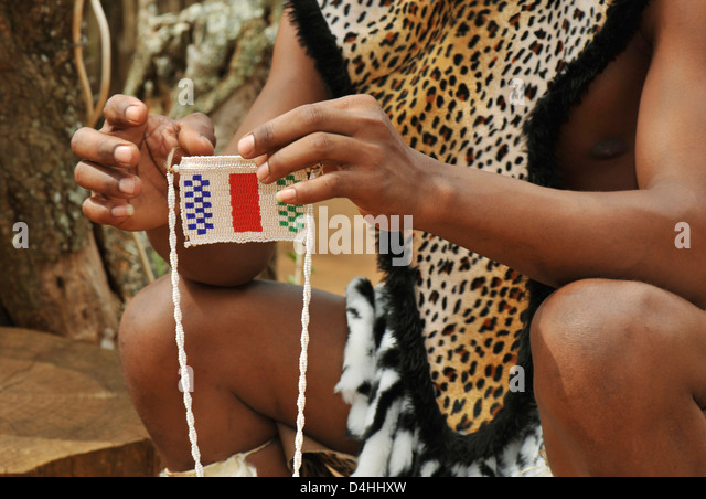 Hands of Zulu man holding traditional bead love message used in courtship South Africa Travel ethnicity Cultures - Stock-Bilder