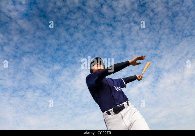 young baseball player taking a swing - Stock Image