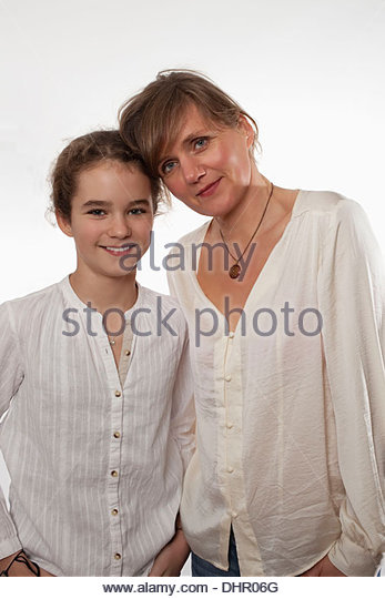 Mother and daughter caring loving smiling holding - Stock Image