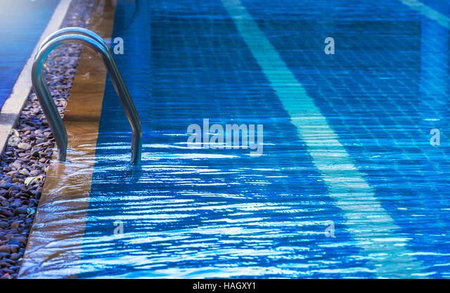 Swimming pool with stair under sun light - Stock-Bilder