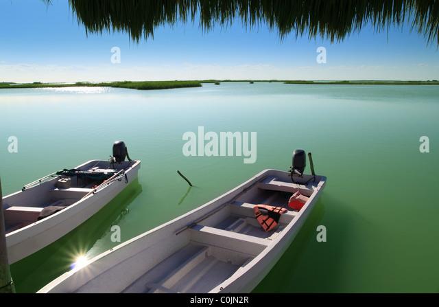 boats in pier mangrove lagoon in Mayan Riviera sian kaan - Stock Image
