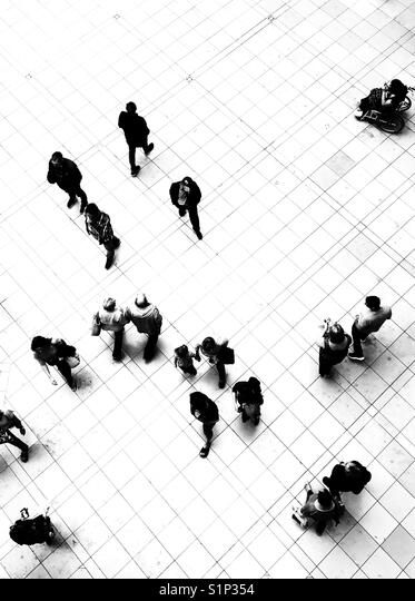 Silhouette of people walking on the ground floor of the Grand Arcade shopping centre in Cambridge, UK - Stock Image