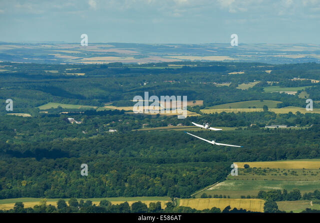 An aerial view of a Glider being towed into the air near Booker Airfield - Stock Image