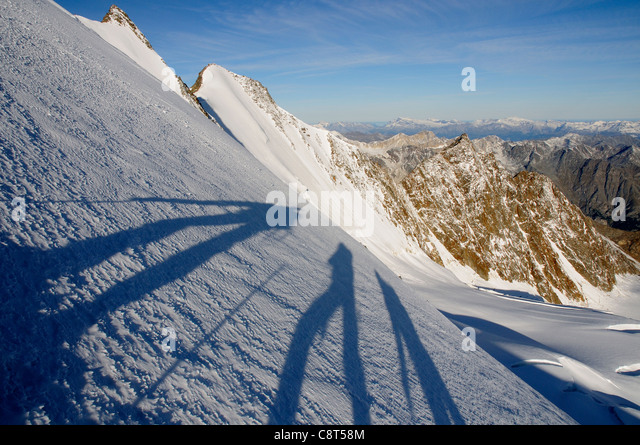 shadows-of-three-climbers-on-the-south-r