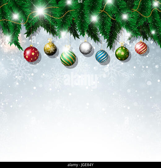 Christmas baubles on a snowflake background - Stock Image