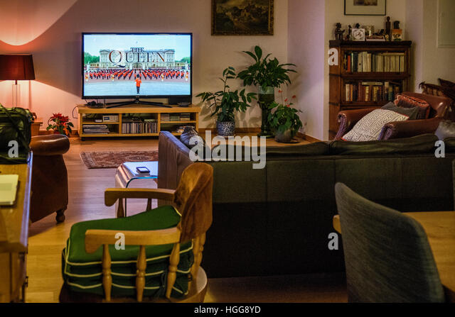 Berlin, Mitte, family living room at Christmas ready for the British Queen's speech on television - Stock Image