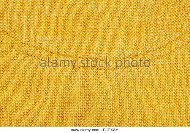 Close up of yellow stitching detail on fabric. The stitching is in the shape of a curve - Stock Image