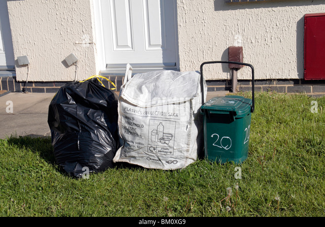 Normal waste black bag, plastics collection container and food waste container outside residence in Hounslow, Middx, - Stock Image