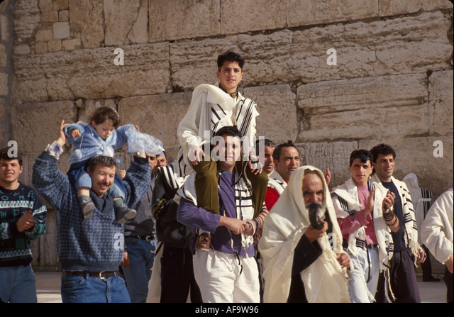 Israel Jerusalem Western Wall holy place Bar Mitzvah celebration 13 year old boy becomes man tradition religion - Stock Image