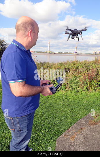 Man flying 3DR RTF X8 drone near River Mersey, Merseyside, England - Stock Image