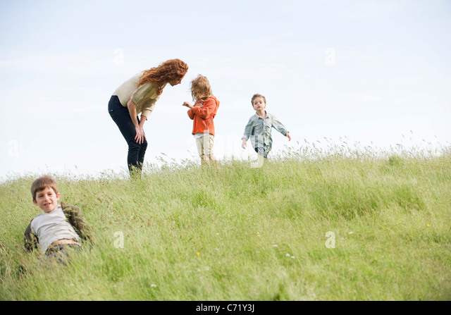 Mother consoling daughter outdoors - Stock Image