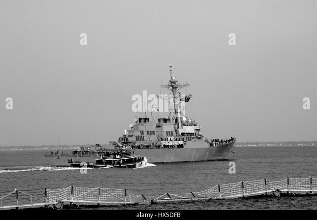The guided-missile destroyer USS Barry (DDG 52) departs Naval Station Norfolk for a ballistic missile defense deployment, - Stock Image