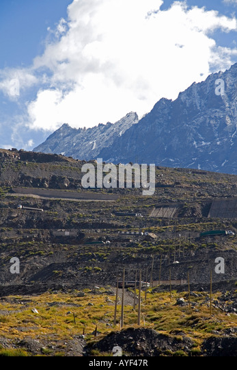 Trucks travel on switchback roads in the Andes Mountain Range in Chile - Stock-Bilder