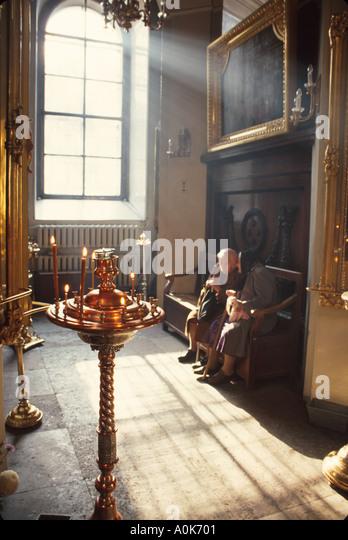 Russia former Soviet Union St. Petersburg Preobrojensky Orthodox Church interior seniors - Stock Image