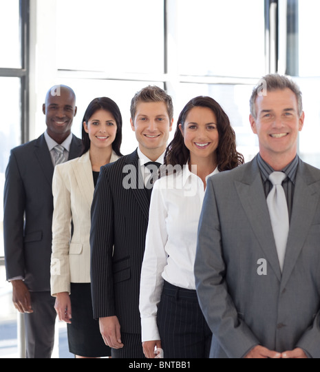 businesspeople from different cultures looking at camera - Stock-Bilder