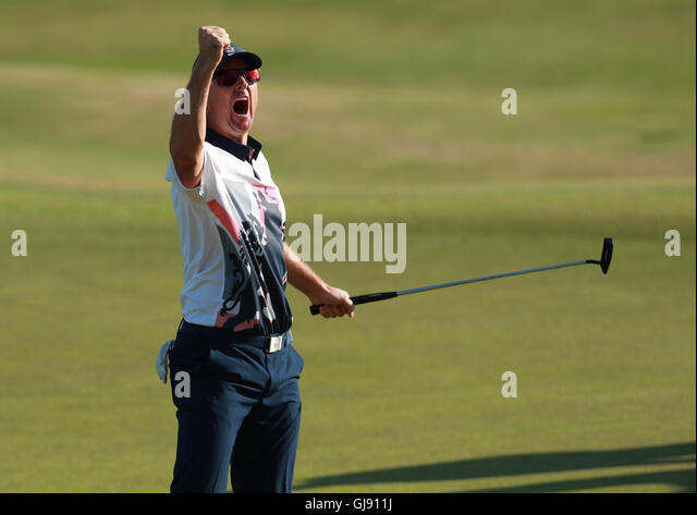 Rio de Janeiro, Brazil. 14th Aug, 2016. RIO 2016 OLYMPICS GOLF - Justin Rose of Britain celebrates gold medal after - Stock-Bilder