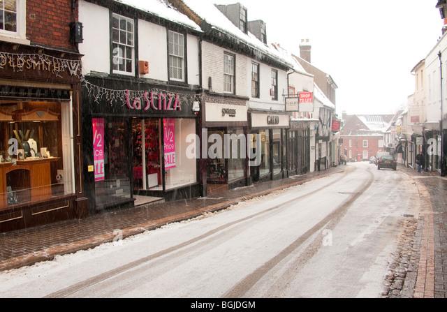 St Albans Herts Hertfordshire George Street winter snow shop - Stock Image