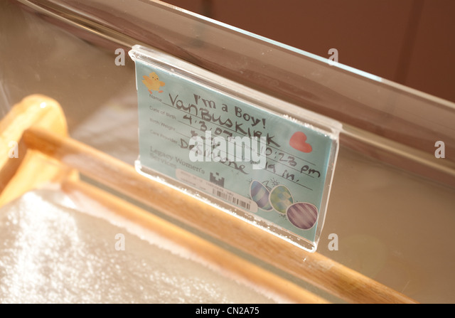 Hospital crib with label for baby boy - Stock Image