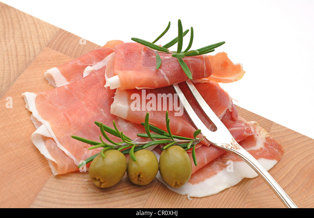 Smoked ham with olives and rosemary - Stock Image