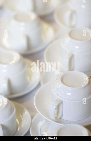 row cups saucers reversed cup gastronomy row coffee cup saucer cups china mass - Stock Image