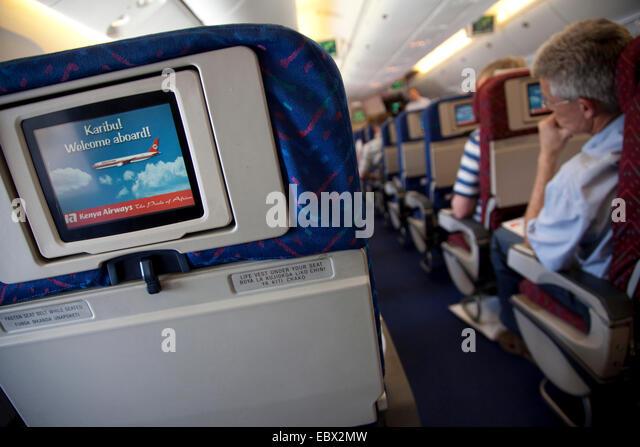row of seats and passengers in an airplane, Kenya, Nairobi - Stock Image