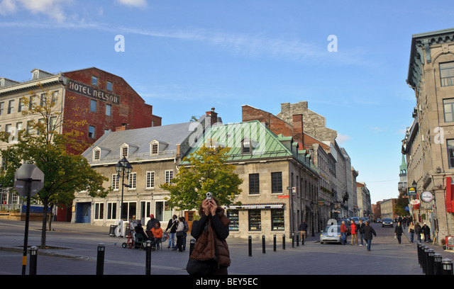 Tourist taking photograph in Old Montreal Quebec Canada - Stock Image