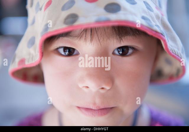 Portrait of girl wearing spotty beanie hat - Stock Image