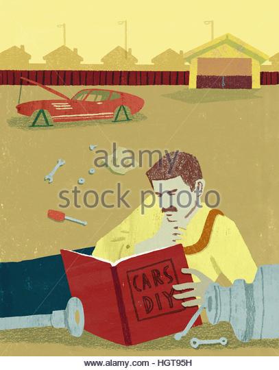 Businessman reading Do It Yourself manual for repairing broken car - Stock-Bilder