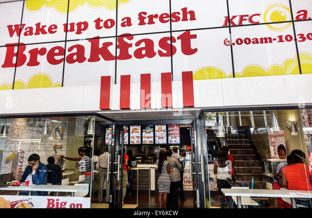 Cape Town South Africa African City Centre center Strand Street KFC fried chicken fast food restaurant front entrance - Stock Image