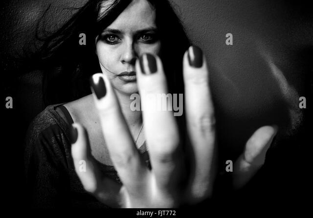 Thoughtful Beautiful Woman Showing Hand - Stock Image