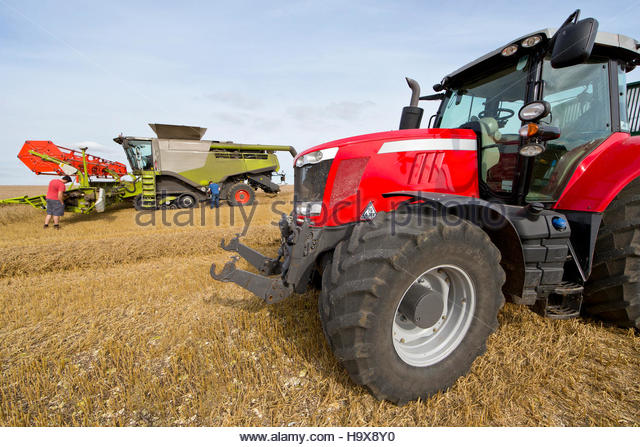 Combine Harvester Being Repaired In Field During Harvest - Stock Image