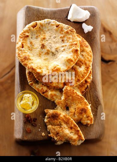 Peshwari Naan. coconut sultanas and honey Bread - Indian Cuisine - Stock Image