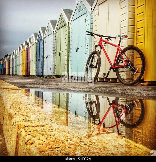 Beach huts and cycling - Stock-Bilder