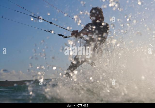 Kite surfer splashing in water - Stock Image