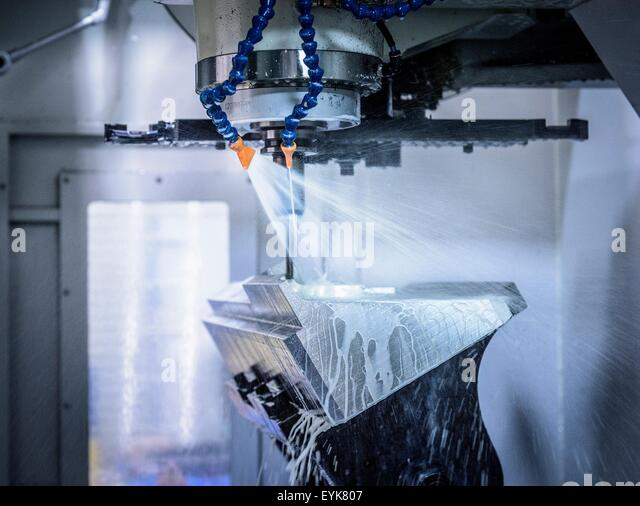 Inside CNC cutting machine in engineering factory - Stock Image
