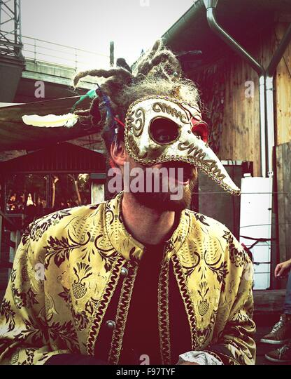 Young Man Wearing Animal Mask While Standing On Street - Stock-Bilder